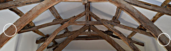 The carpenters' markings on one pair of beams.
