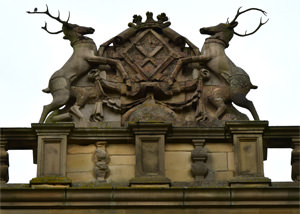 The Hardwick coat of arms atop the west façade - with real antlers fixed to stone