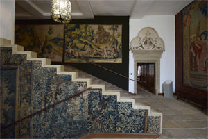 Tapestries flank the steps up through the house to Hardwick's state rooms