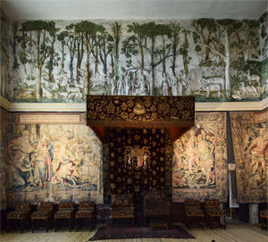 Detail of Hardwick Hall's High Great Chamber frieze with canopied chairs