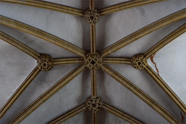 Close-up view of Lincoln nave vault stonework and bosses