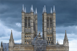Lincoln Cathedral viewed from across Castle Hill, spectral in front of storm clouds