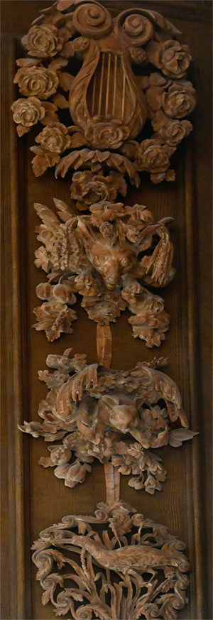 16/23 Playful detail of a fox chasing a rabbit in Petworth's Carved Room