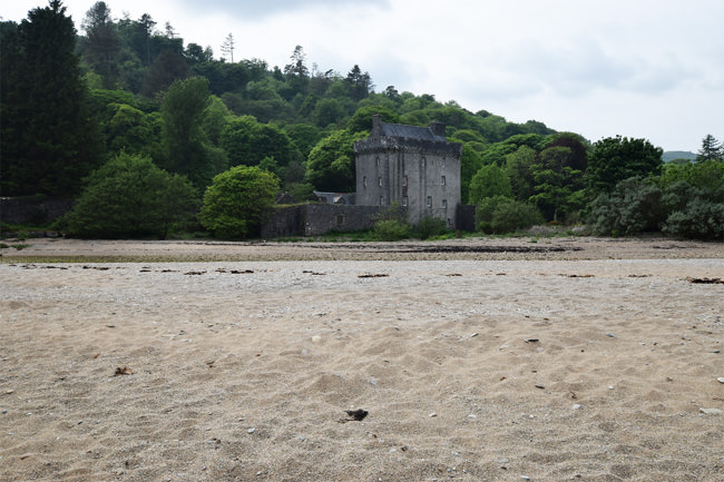 Saddell Castle in its sandy bay