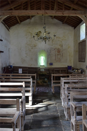 The blue-green of Cardigan Bay waters illuminate the interior of St. Celynin's Church at Llangelynnin