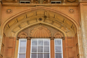 Sezincote east façade, detail of the arch above the front door, rising right up to the deeply-projecting cornice