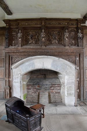 9/12 The ornately carved overmantel in Stokesay Castle's oak-panelled solar
