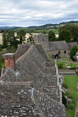 Stokesay Castle looking north over the Church of St. John the Baptist towards the Long Mynd